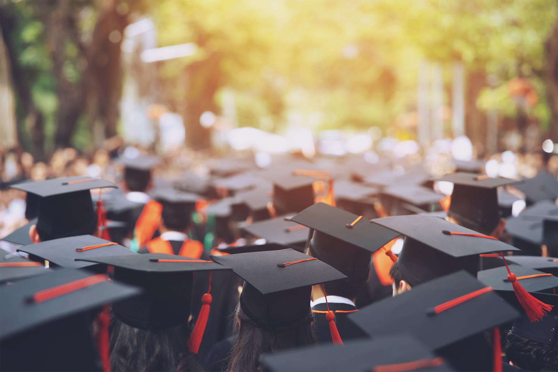 backside graduation hats during commencement success graduates o